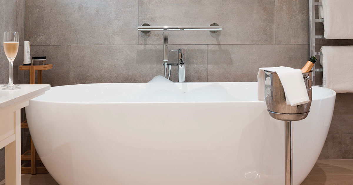 Taittinger & Free Standing Bath Tub | Hay Loft Suites at The Montagu Arms